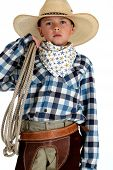 Adorable Young Cowboy Wearing A Large Cowboy Hat Holding A Rope