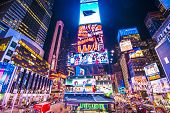 NEW YORK, NEW YORK - APRIL 9, 2013: Times Square lights at night in Midtown Manhattan. The site is r