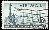 USA-CIRCA 1947: A 15 cent United States Airmail postage stamp, shows image a Lockheed Constellation airplane over New York Skyline and Statue of Liberty, circa 1947.