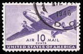 USA-CIRCA 1941: A 10 cent United States Airmail postage stamp shows image of a twin-engined transpor