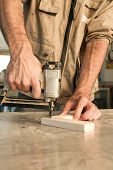 picture of joinery  - joinery uses a nail gun to attach pieces of wood - JPG