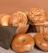 A variety of freshly baked bagels including plain, cinnamon raisin, blueberry, and Everything