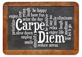 Carpe DIem word cloud on a vintage slate blackboard isolated on white