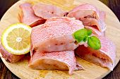 pic of grouper  - Chunks of red grouper fillets lemon basil on a wooden boards background - JPG
