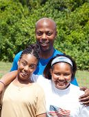 African-american family consisting of father, mother, and adolescent daughter.  Mother has cerebral-