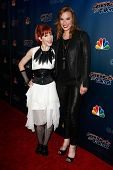 NEW YORK-AUG 6: Rock violinist Lindsey Stirling (L) and singer Lzzy Hale of Halestorm attend 'America's Got Talent' post show red carpet at Radio City Music Hall on August 6, 2014 in New York City.
