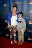 NEW YORK-AUG 6: Pianist Adrian Romoff (R) and mother Olga attend the 'America's Got Talent' post show red carpet at Radio City Music Hall on August 6, 2014 in New York City.