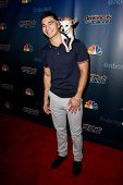 NEW YORK-AUG 6: Christian Stoinev and his dog Scooby attend the 'America's Got Talent' post show red carpet at Radio City Music Hall on August 6, 2014 in New York City.