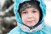 Portrait Of A Boy With Wet Snow From The Face Of