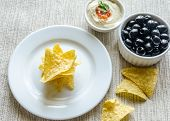 Corn Chips With Hummus And Olives