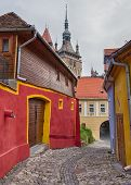 Ancient alley in Sighisoara, Romania.