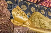 Reclining Buddha Gold Statue In Temple Of Thailand.