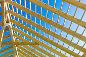 wooden roof construction, symbolic photo for home, home construction, and home financing