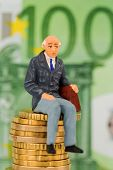 picture of retirement age  - pensioners sitting on money stack - JPG