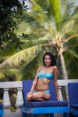 Brunette Girl In Blue Swimming Suit