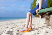 Boy's Feet At The Beach