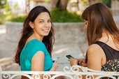 Latin Teens Texting At A Park