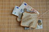 White Bread, Euro Banknotes And Wheat Ears