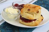 Homemade scone with jam and clotted cream