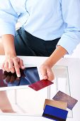 Woman using digital tablet and holding credit card in her hand. On-line shopping concept