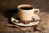 Cup of coffee on rustic wooden background