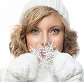 portrait of attractive young caucasian woman   face skin care in warm clothing  studio  shot isolated on white  winter snowflake
