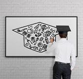 Businessman Drawing Bachelor Cap