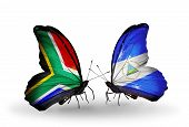 Two Butterflies With Flags On Wings As Symbol Of Relations South Africa And Nicaragua