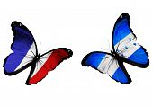 Concept - Two Butterflies With French And Honduras Flags Flying, Like Two Football Teams Playing
