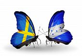 Two Butterflies With Flags On Wings As Symbol Of Relations Sweden And Honduras