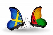 Two Butterflies With Flags On Wings As Symbol Of Relations Sweden And Guinea Bissau