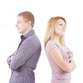 picture of young men  - On the isolated background the woman and the man stand backs to each other - JPG