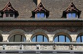 picture of zurich  - Detail of medieval building with dormers, arch windows and mural walls, Zurich, Switzerland.