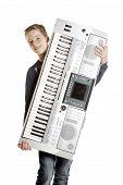 Teenage Boy Carries Keyboard In Studio