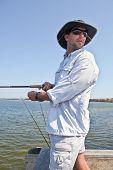 Man Fishing From Pier