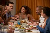 Group Of Friends Enjoying Dinner Party At Home Together