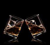 Isolated shots of whiskey glasses on black background