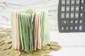 Close Up Stack Bill Over Gold Coins