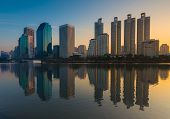 image of reflection  - Bangkok city downtown sunrise with reflection of skyline - JPG