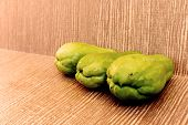 Three Chayote On Wooden Background