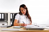 Business Woman Writing At A Desk