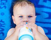 Pretty Baby Girl Drinking Milk