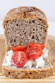 Slice Of Wholemeal Bread With Cottage Cheese And Cherry Tomatoes