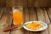 Toast With Orange Marmalade On Wooden Background