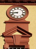 Clock face on exterior deco building.