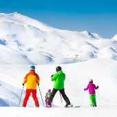 stock photo of family ski vacation  - Family on winter ski vacations in ski slopes in Alps - JPG
