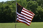 stock photo of civil war flags  - Civil War era United States flag at a battle reenactment - JPG