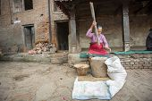 BHAKTAOUR, NEPAL - DEC 07, 2013: Unidentified Nepalese woman working in the his pottery workshop. More 100 cultural groups have created an image Bhaktapur as Capital of Nepal Arts.