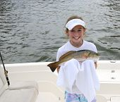 Young Girl holding Fish in a Towel