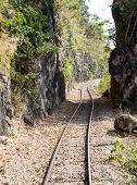 pic of split rail fence  - Defile railway line near the high mountain - JPG